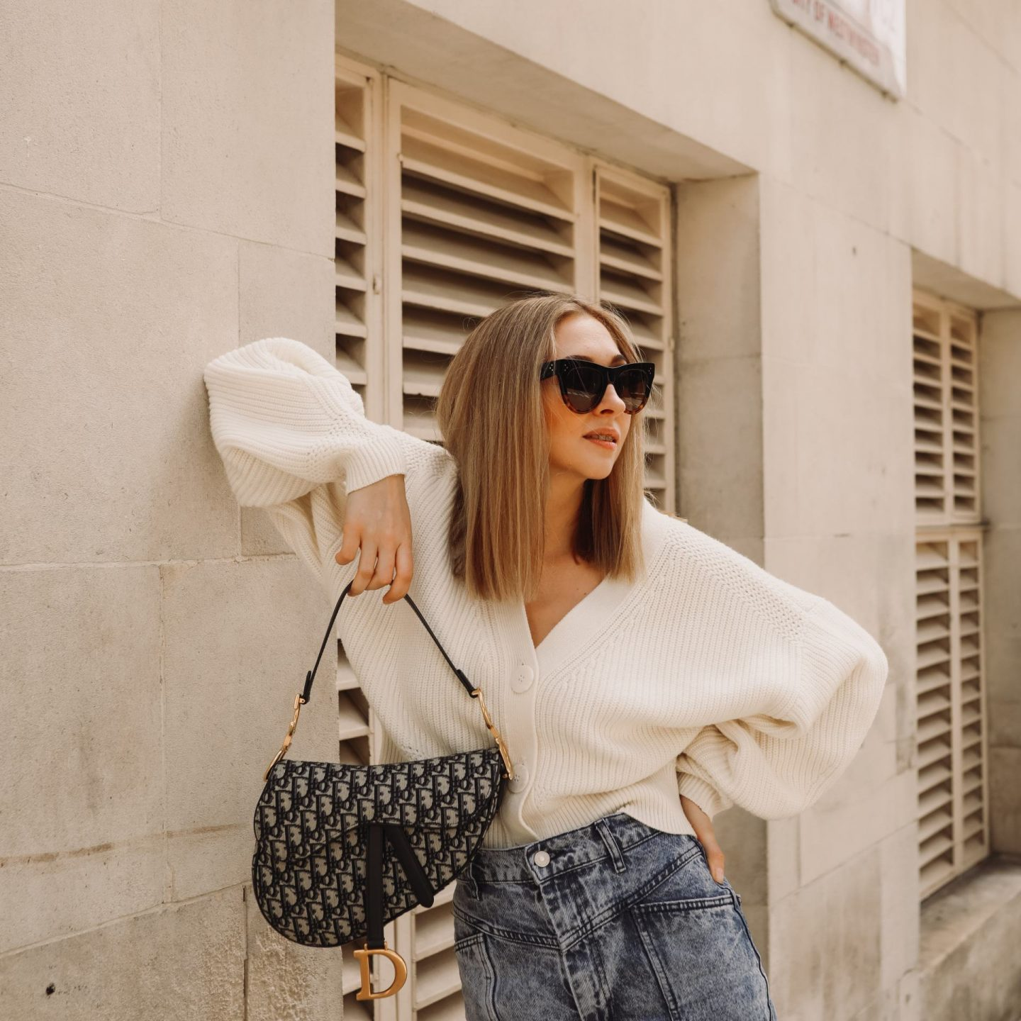 White oversized sweater and Dior Saddle bag